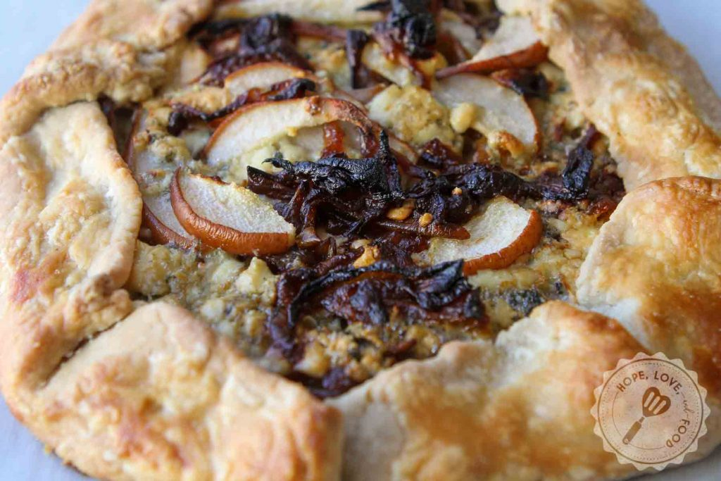 Pear and gorgonzola cheese galette with caramelized onions.