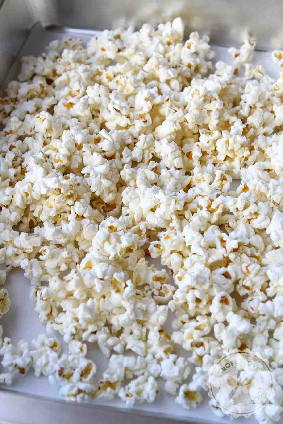 Popcorn on parchment-lined baking pan.