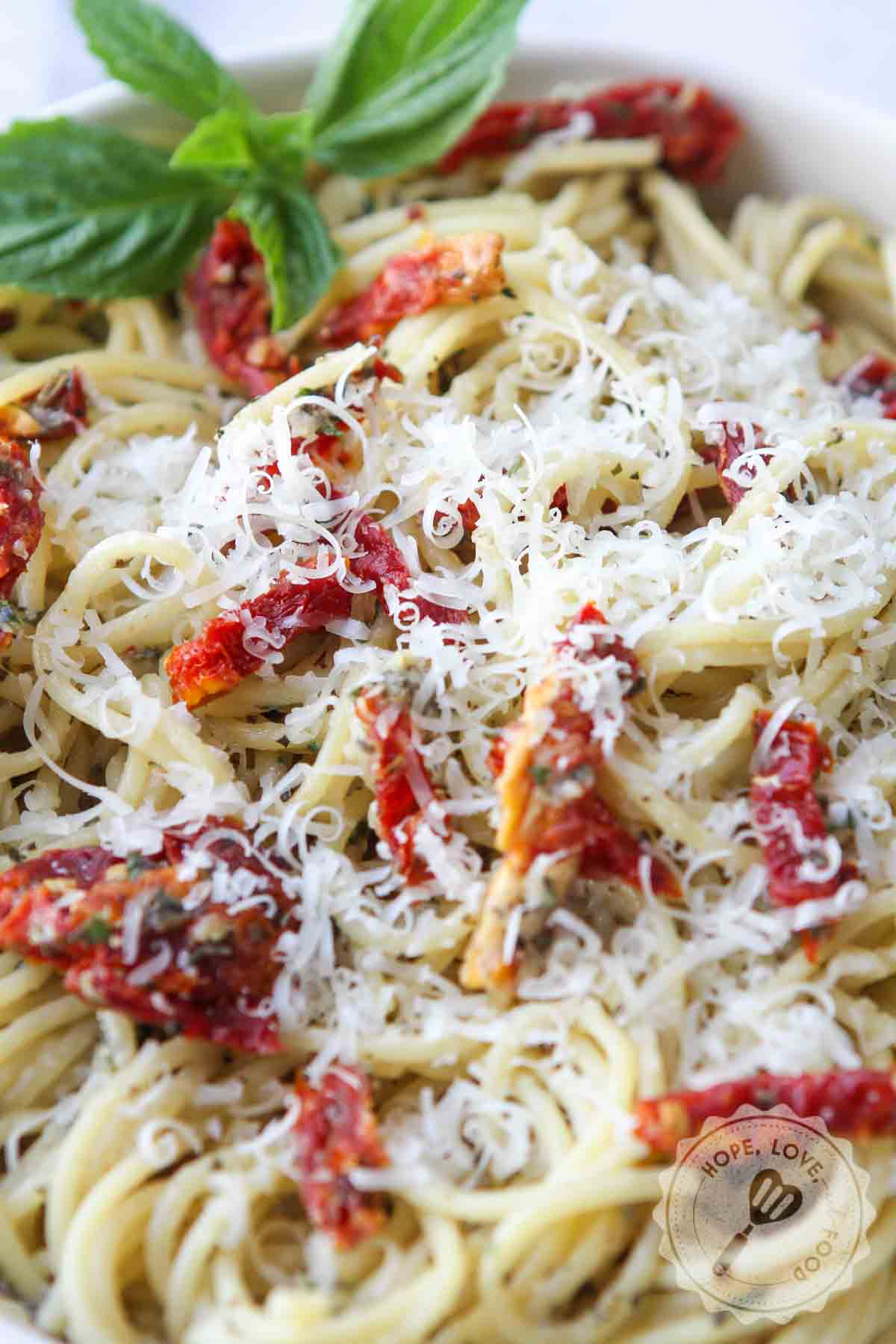 Grated cheese on top of garlic pasta.