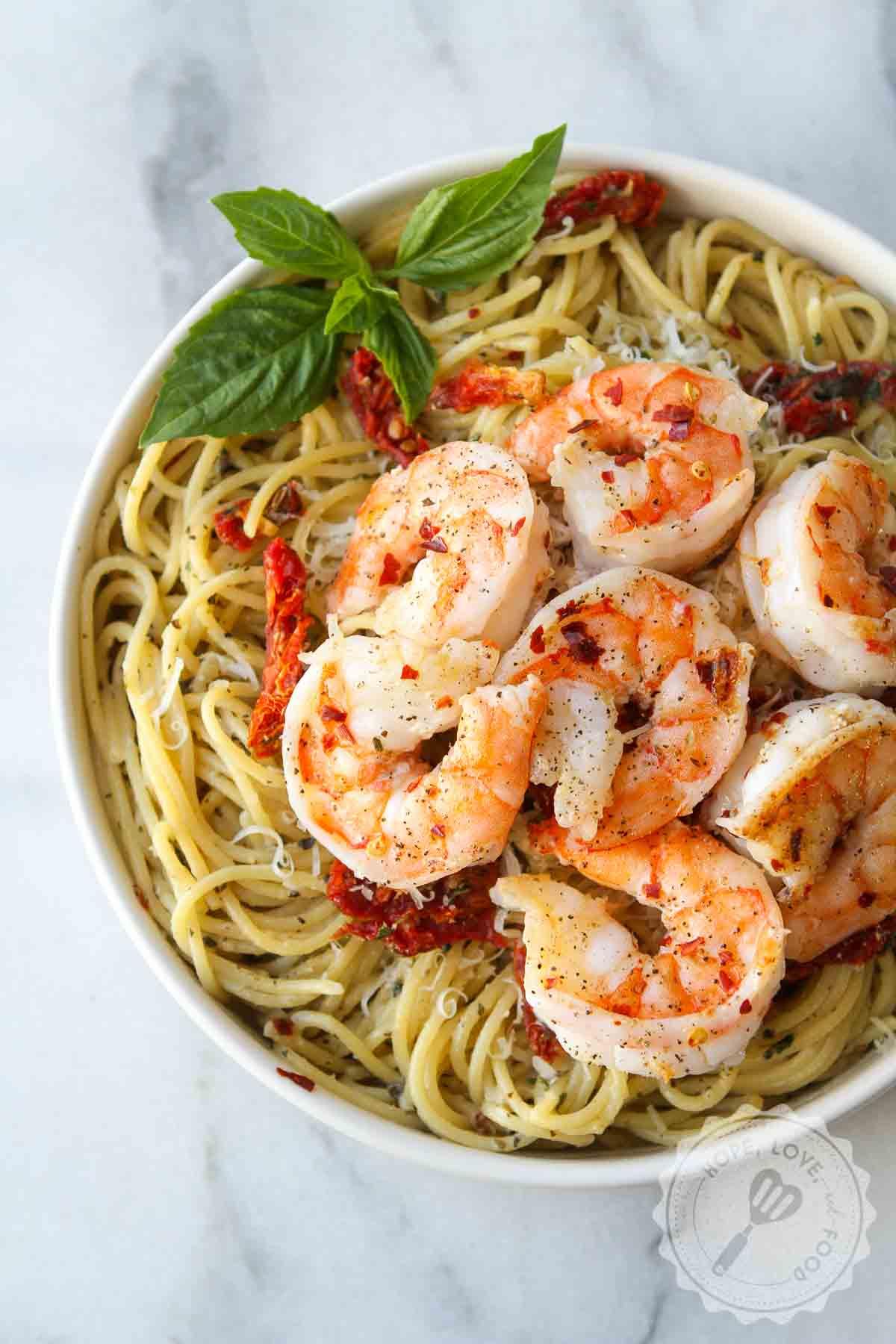 Shrimp on roasted garlic pasta.