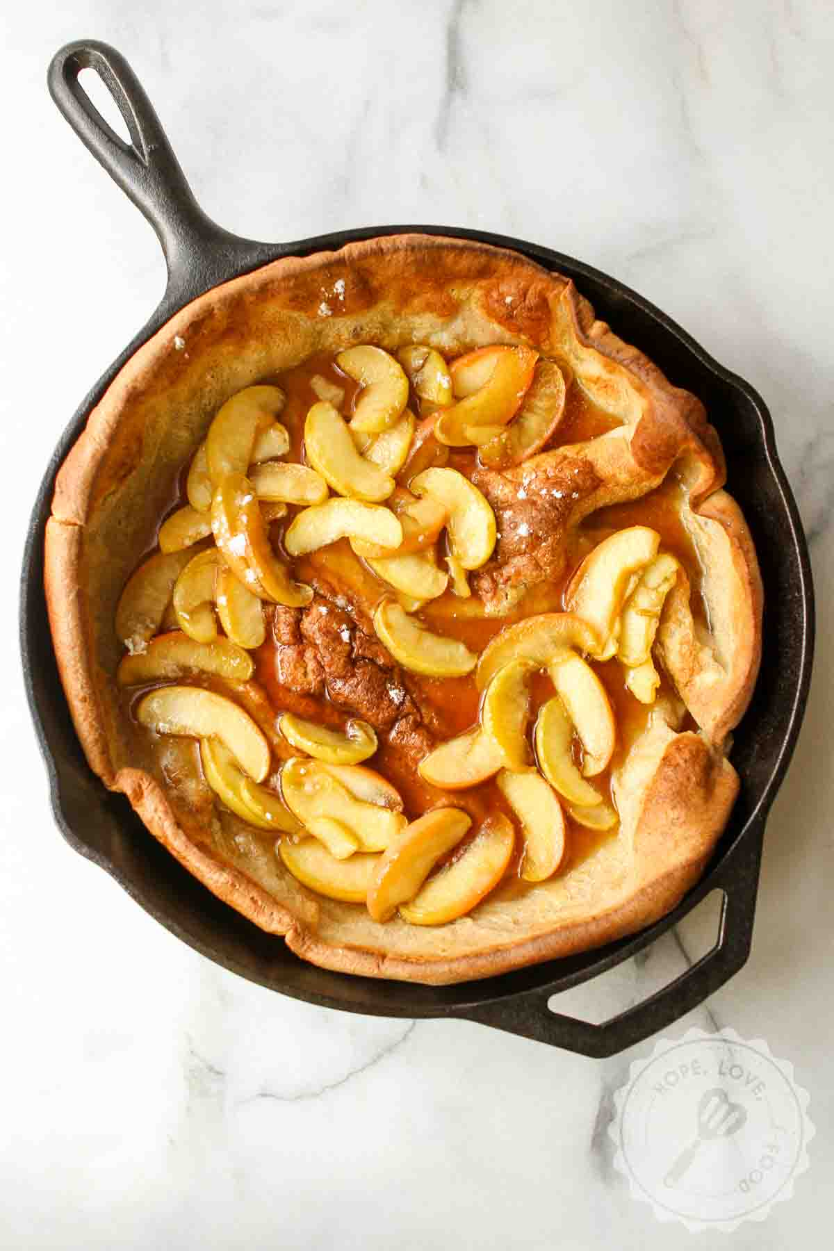 Apple Dutch baby in cast-iron skillet.